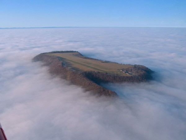 airplane-landing-strip-on-hill-above-fog-farrenberg-aerodrome-germany-far1